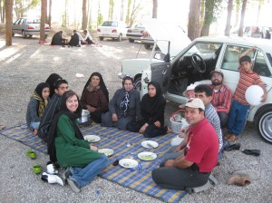 Eating homemade soup with an Iranian family in the parking lot of Persepolis.