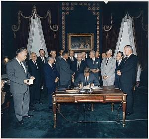 President Kennedy signs the Limited Test Ban Treaty in 1963