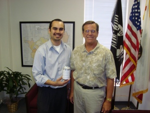 Craig delivers a can to a staff person in Rep. Linda Sanchez's office.