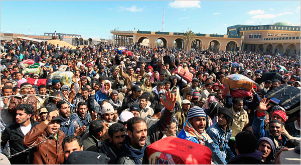 Refugees waiting at the Libyan and Tunisian border crossing of Ras Jdir. Tunisian border guards fired in the air and used sticks to control the crowds. Zohra Bensemra/Reuters