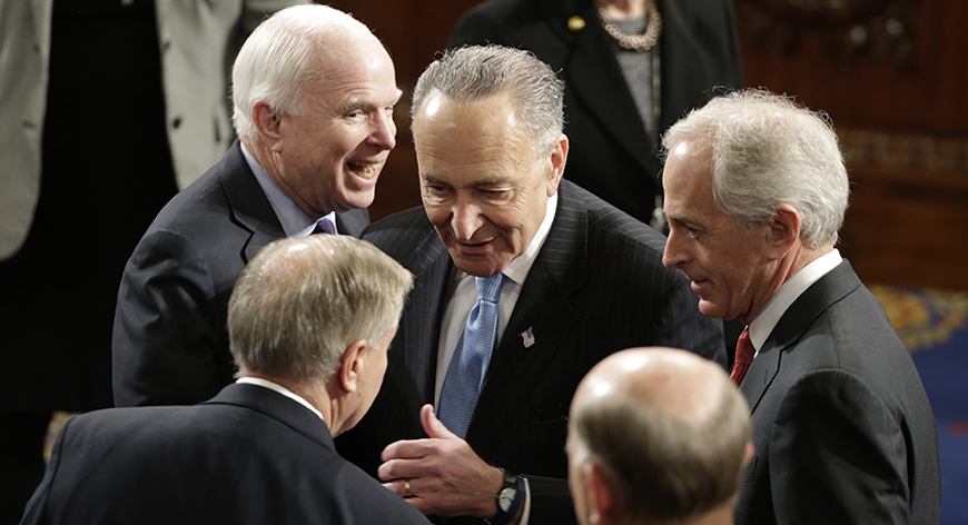 U.S. Senators' Lindsey Graham (front L) (R-SC), John McCain (Back L) (R-AZ), Charles Schumer (C) (D-NY) and Bob Corker (R) (R-TN) talk on the floor of the House Chamber prior to Israeli Prime Minister Benjamin Netanyahu's address to a joint meeting of Congress in the House Chamber on Capitol Hill in Washington, March 3, 2015. REUTERS/Gary Cameron (UNITED STATES  - Tags: POLITICS)   - RTR4RX59